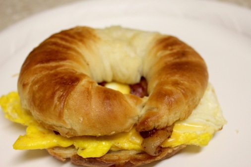 Croissant with eggs, bacon and cheese (YUM)